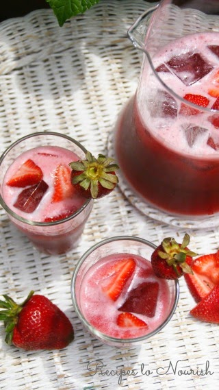 Hibiscus Strawberry Iced Tea Cooler is the perfect drink for rehydrating. Full of flavor + not too sweet. | Recipes to Nourish
