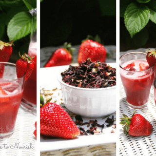 Hibiscus strawberry herbal iced tea in glasses and pitcher with dried hibiscus in a bowl and fresh strawberries.