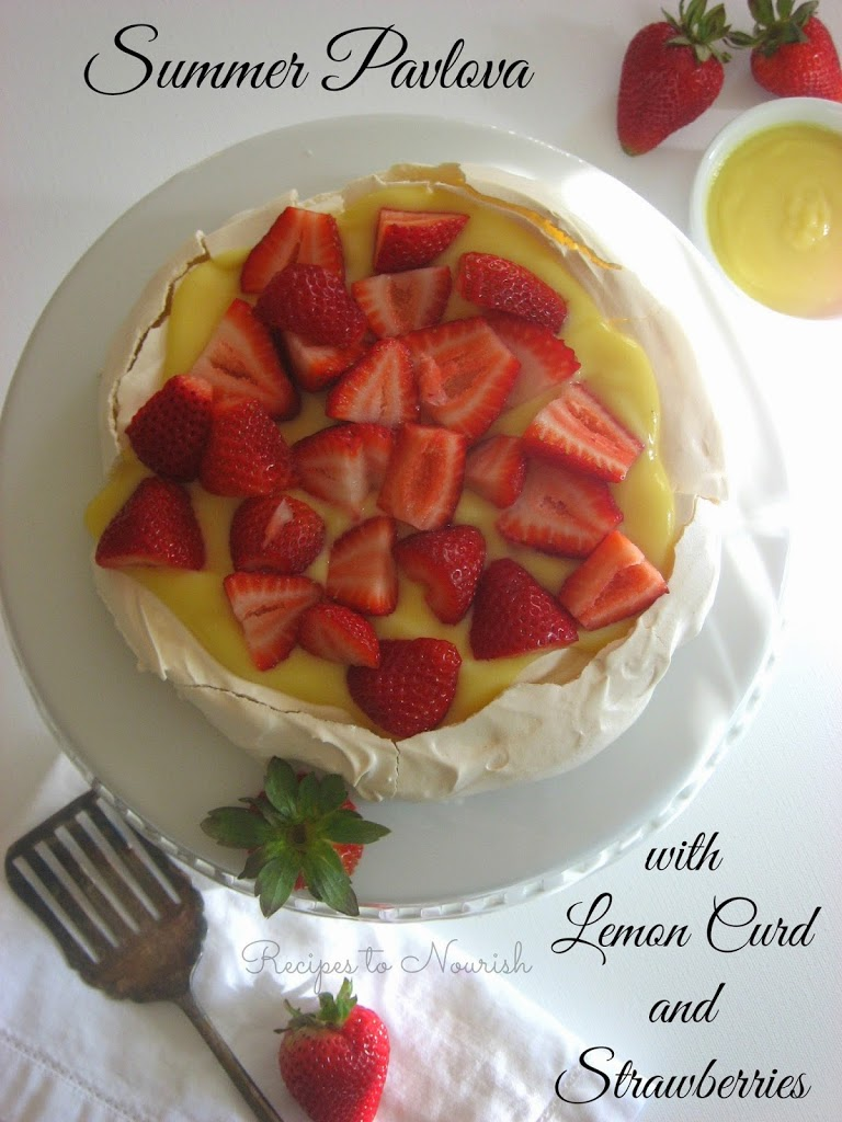 """Summer Pavlova with Homemade Lemon Curd + Strawberries... this delicious meringue """"cake"""" is crisp on the outside + soft and chewy on the inside. 