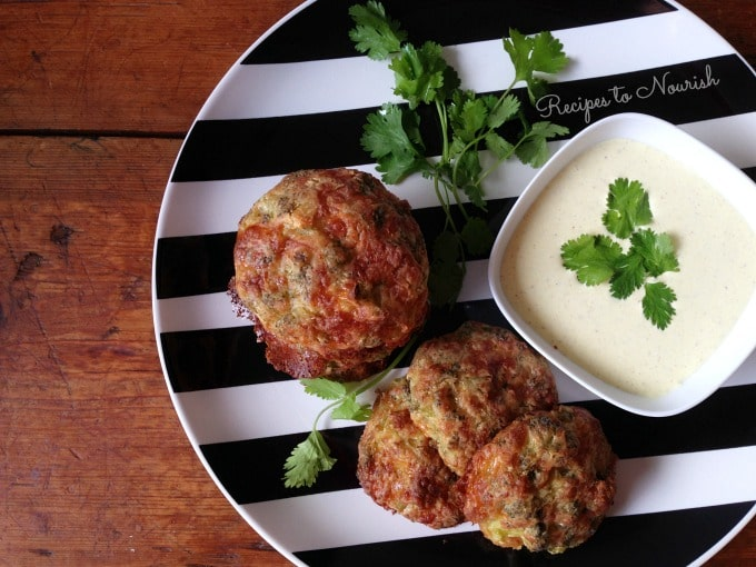 Broccoli fritters with a side of creamy dipping sauce.