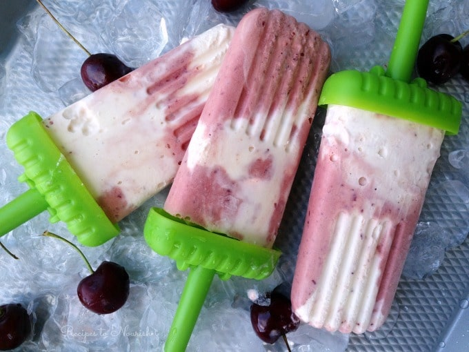 Cherry Creamsicles ... old fashioned creamsicle anyone? Creamy vanilla goodness paired with sweet, fruity, icy deliciousness. What's not to like? | Recipes to Nourish