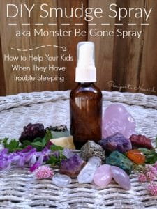 Essential oil spray bottle with crystals.