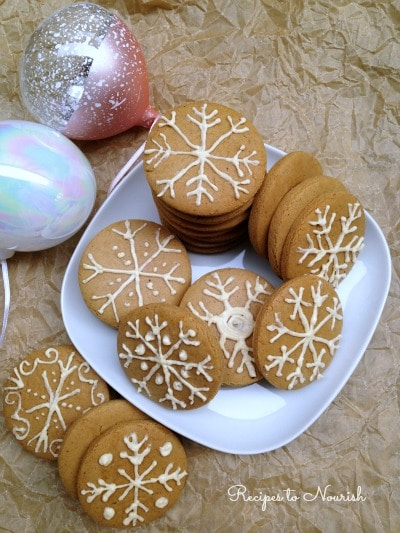 Gingerbread cookies frosted like snowflakes.