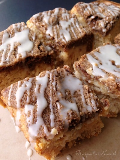 Large squares of coffee cake with a streusel topping and a glaze drizzle over the tops.
