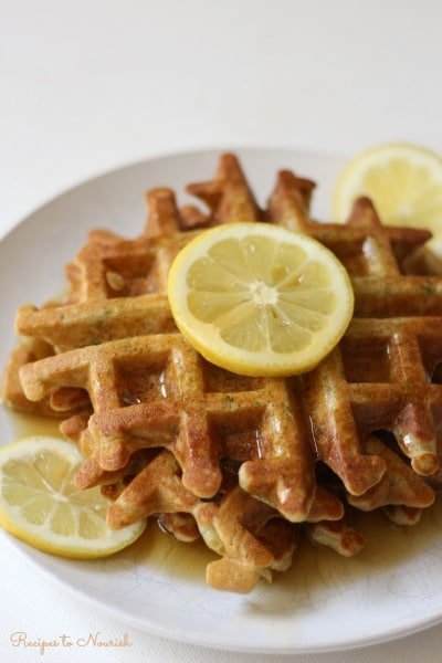 Waffles with fresh lemons and maple syrup.