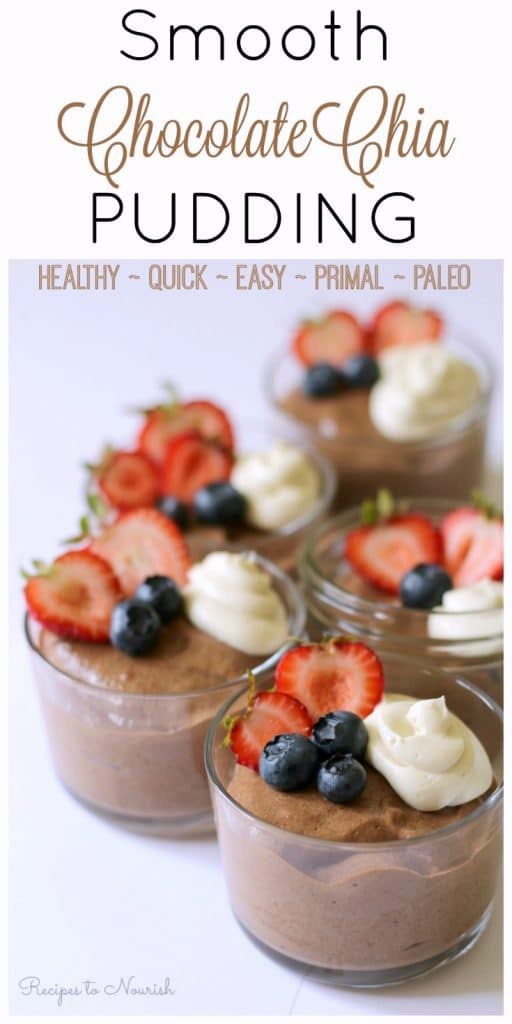 Jars of chocolate chia pudding topped with fresh berries and whipped cream.
