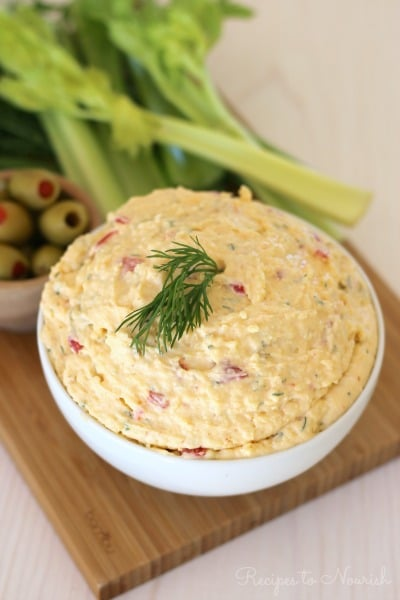 Real Food Pimento Cheese is a common Southern comfort food. This delicious cheese spread is made with a base grated sharp cheddar cheese, chopped peppers, and a little bit of mayonnaise. Serve it with fresh vegetables, green olives, chips, crackers, spread onto a sandwich, topped on a burger or made into a grilled cheese. | Recipes to Nourish