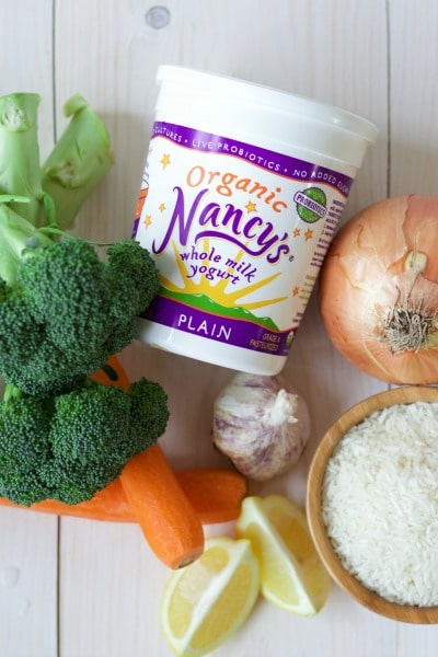 Nancy's brand organic whole milk yogurt and fresh broccoli, carrots, garlic, lemon, onion and white rice.