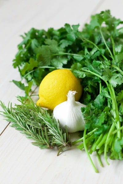 Fresh cilantro, lemon, rosemary and garlic.