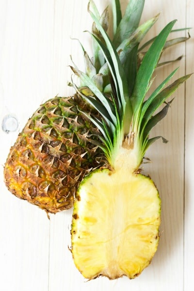 Fresh pineapple cut in half.