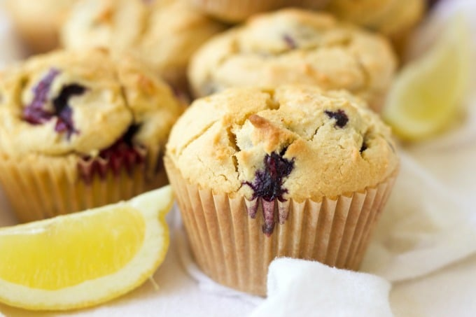 Blueberry muffins and fresh lemon slices.