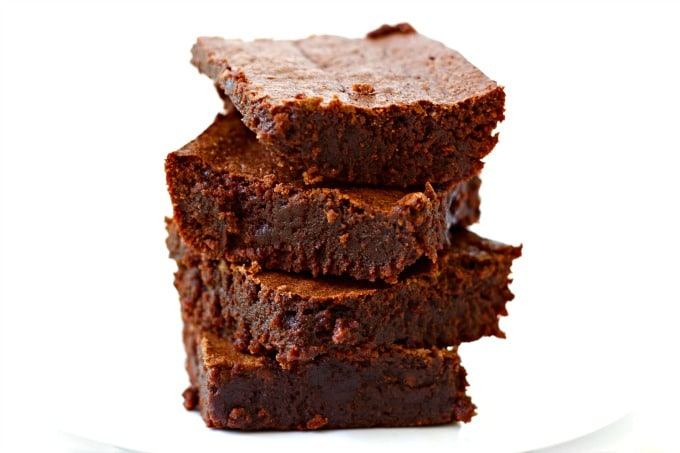 These decadent Fudgy Grain Free Brownies are out-of-this-world, crazy good. They're chewy with a nice crusty bite on top, made without refined sugar, naturally gluten free, Paleo-friendly and freeze beautifully too! You would never know these irresistible brownies are grain free. | Recipes to Nourish