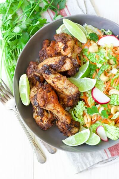 30 minute Moroccan Chicken Wings with sesame-bok choy slaw and cashews is a delicious spin on classic chicken wings. With a citrusy sumac and ras el hanout spice blend, these crispy wings go perfectly with a refreshing, cold, crunchy slaw made with fresh greens, veggies, nutty cashews and a sesame dressing. | Recipes to Nourish