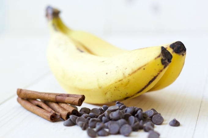 Two bananas, cinnamon sticks and chocolate chips.