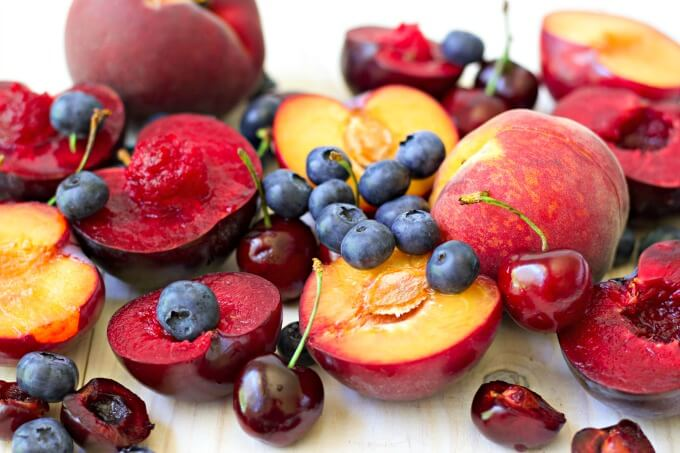 Fresh summer cherries, blueberries, plums and peaches.