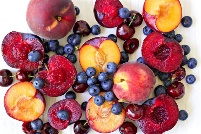 Fresh summer peaches, plums, cherries and blueberries.