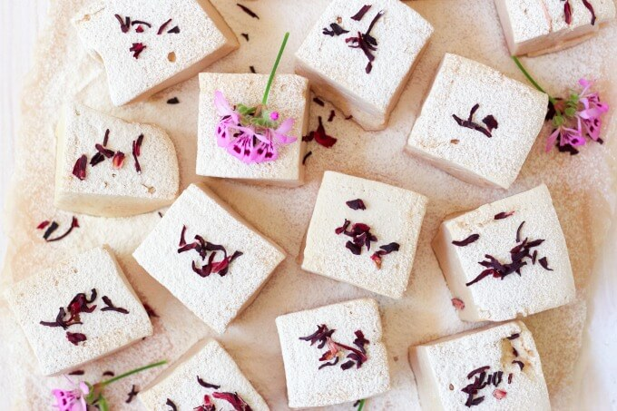 Square cut homemade marshmallows with dried hibiscus blossoms.