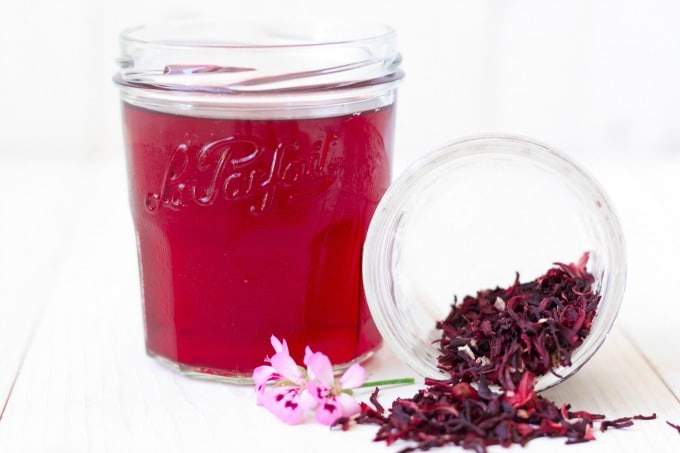 Hibiscus herbal tea and dried hibiscus blossoms.