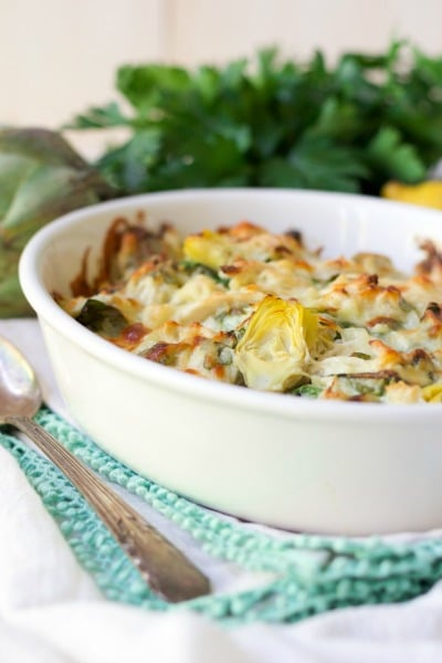 Healthy Spinach Artichoke Chicken Casserole with fresh parsley.