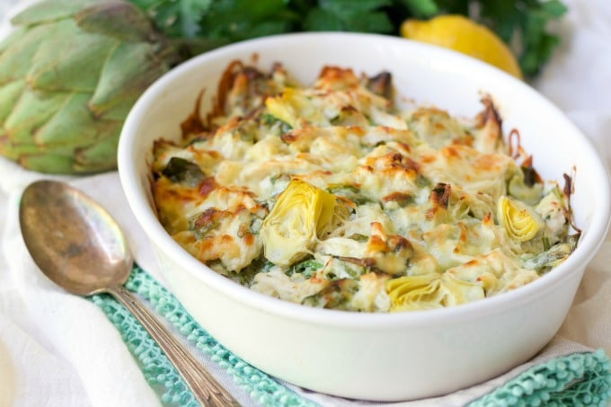 Healthy Spinach Artichoke Chicken Casserole with artichoke, fresh lemon and parsley.