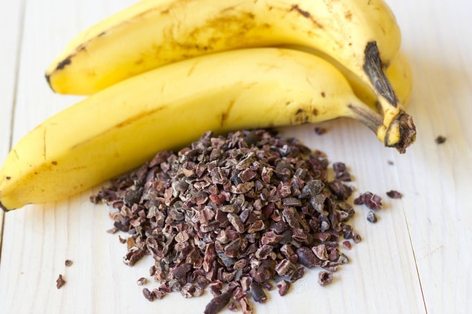 Two ripe bananas and chocolate cacao nibs.