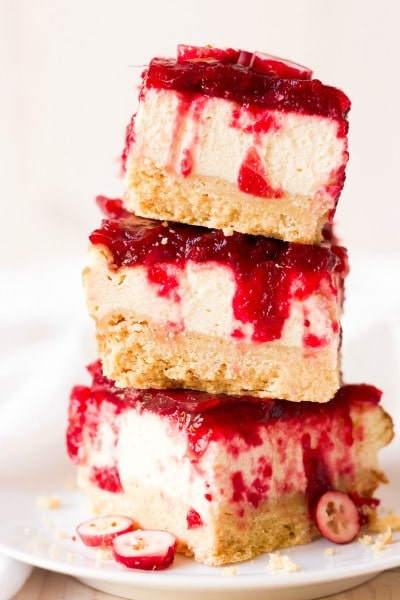 (ad) These Healthy Grain Free Cranberry Cheesecake Bars are so festive and perfect for the holidays! They're made with a homemade shortbread crust, protein-rich cheesecake center and topped with a naturally sweetened cranberry sauce. | Recipes to Nourish
