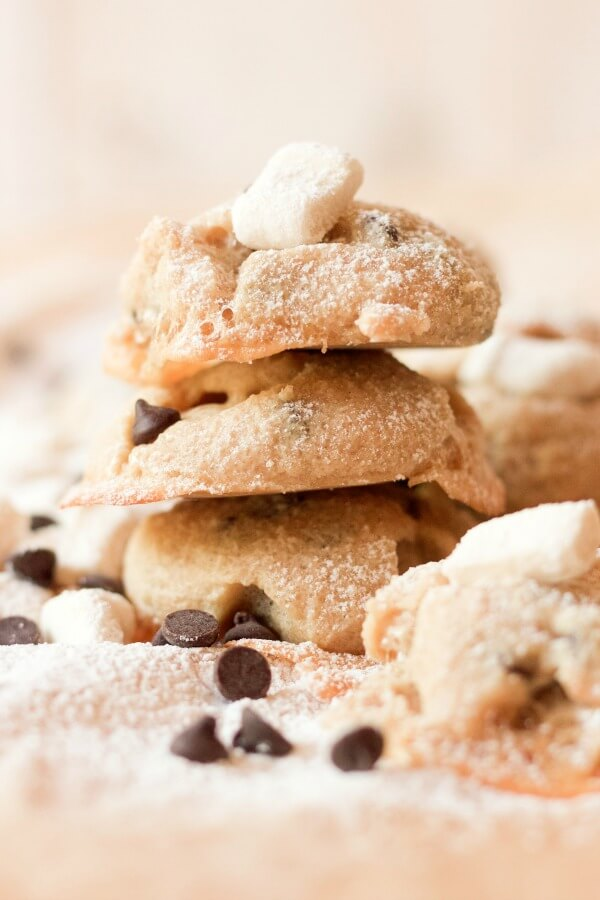 Stacked s'mores cookies with mini homemade marshmallows and chocolate chips.