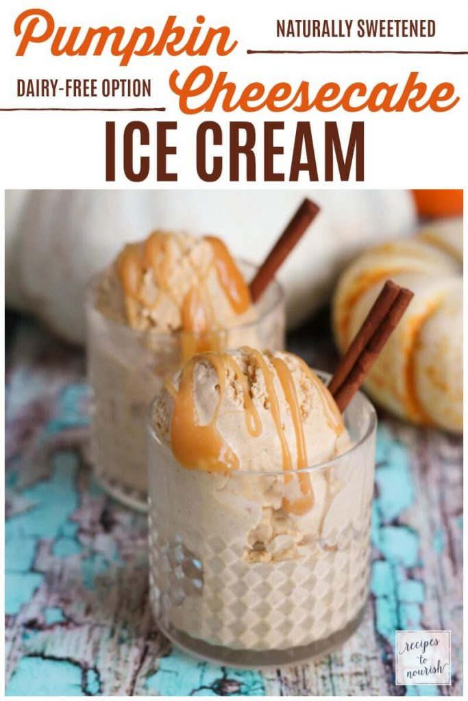 Scoops of ice cream in glasses with caramel drizzled over the top with cinnamon sticks next to pumpkins.
