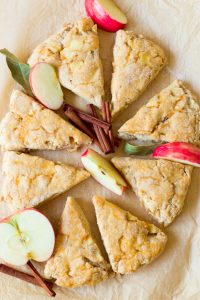 Apple scones with fresh apples and cinnamon sticks.