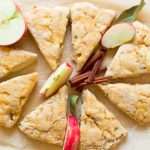 Apple scones with fresh apples and cinnamon sticks.
