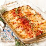 Scalloped potato casserole with bacon and thyme on top.