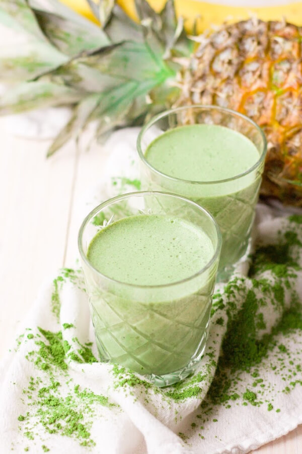 Green smoothies with matcha powder, pineapple and banana.