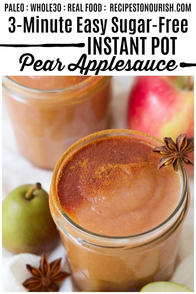 Jars of homemade pear applesauce topped with ground cinnamon next to fresh pears, apples and star anise pods.