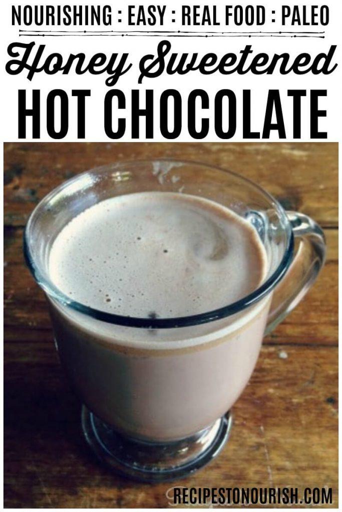 Glass mug full of homemade hot chocolate.